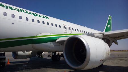 iraqi: One of the Iraqi Airways planes are parked at the Baghdad International Airport It is a white Marked with a green scarf and bearing the logo of the swallow.