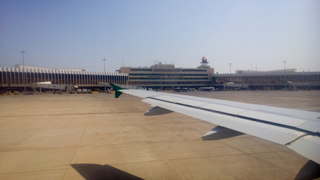 administrative buildings: Baghdad international airport in Baghdad and show building welcoming passengers. It is the largest airport in Iraq.