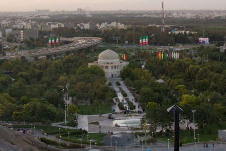 imam: Mashhad Iran   August 30 2014: Aerial view of the Holy City of Mashhad and the shrine of Imam Reza Show some high buildings And some mountains and high plateaus and terrain to the city.