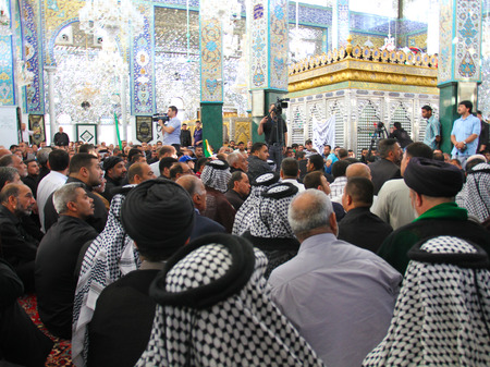 damascus: nternal shot for Sayeda Zeinab shrine in Damascus capital of Syria, Which show some visitors, Embroidered and a golden cage represents her grave. Editorial