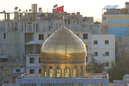 damascus: external shot for dome of Sayeda Zeinab shrine in Damascus capital of Syria which showing the shrine with one golden dome.