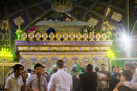 visitors: Internal picture of the tomb of Lady Rqiah in DamascusWhich show some visitors Embroidered and a golden cage represents her grave.