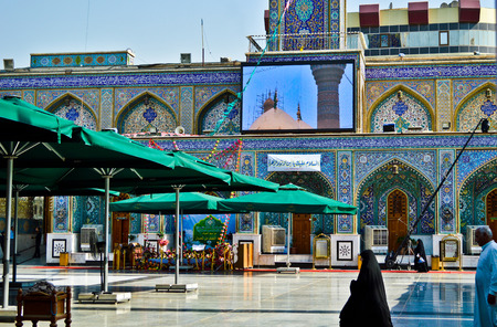 minarets: A picture of a Shiite shrine Musa al-Kadhim and his grandson Mohammed Jawad, It is a shrine of two gold domes and four minarets and a large courtyard, Located in the city of Kadhimiya in Baghdad.