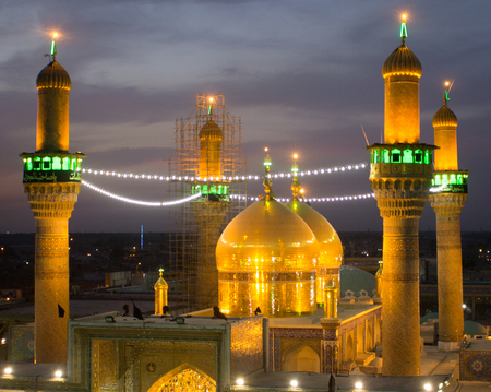 imam: A picture of a Shiite shrine Musa al-Kadhim and his grandson Mohammed Jawad, It is a shrine of two gold domes and four minarets and a large courtyard, Located in the city of Kadhimiya in Baghdad.