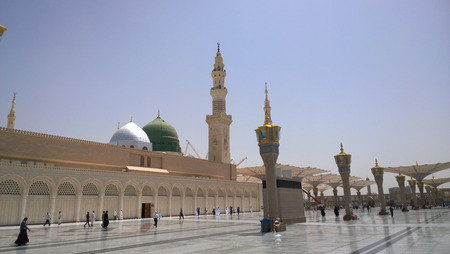the prophets: An external image of the Prophets Mosque in Medina in Saudi Arabia,  It shows the minarets and green dome and sliver dome of the mosque.