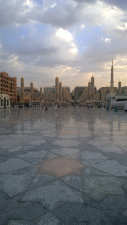 minarets: An external image of the Prophets Mosque in Medina in Saudi Arabia, Show It shows umbrellas which protects from the sun and the minarets of the mosque