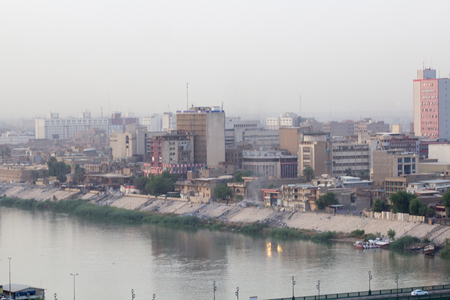 complexes: Aerial photo of the city of Baghdad, and shows where residential complexes and the Tigris River and bridges. The city of Baghdad, capital of Iraq.