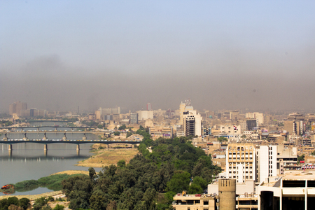 tigris: Baghdad, Iraq – September 21, 2015: Aerial photo of the city of Baghdad, and shows residential complexes and the Tigris River and bridges. The city of Baghdad, capital of Iraq.