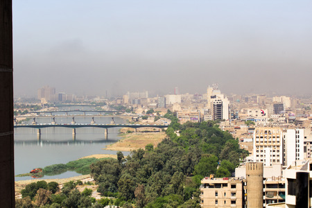 complexes: Baghdad, Iraq – September 21, 2015: Aerial photo of the city of Baghdad, and shows residential complexes and the Tigris River and bridges. The city of Baghdad, capital of Iraq.