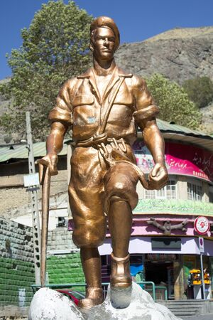 mountainous: picture of the Statue of Iranian climber, it's a bronze statue, Located in the mountainous area north of Tehran, Frequented by climbers to practice their sport.