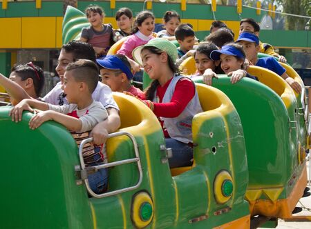 iraqi: picture for Iraqi kids riding some games in  Zawraa park in Baghdad city capital of Iraq. Editorial