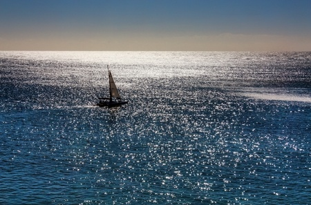 sailing boat: small sailing boat on turquoise ocean Stock Photo