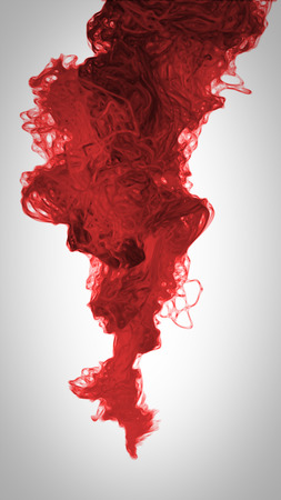 red color paint pouring in water Abstract Stock Photo