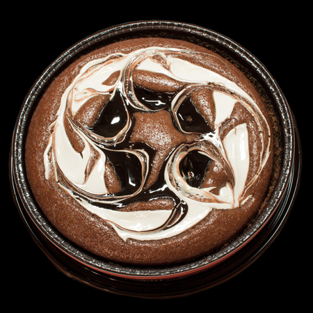 watered: Chocolate cake, cheesecake watered cream and chocolate isolated. Stock Photo