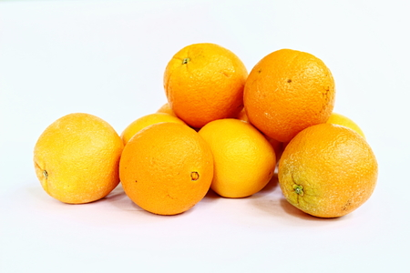 Pile of organic fresh navel oranges isolated on white background. Stock Photo