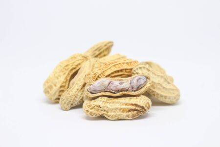 Pile of boiled peanuts on white background.