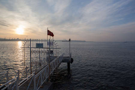 pierce: Sunset over the sea, pierce and Turkish flag, Istanbul Stock Photo