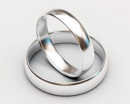 silver wedding anniversary: Platinum wedding rings on white background