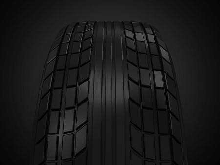 retreading: Car Tire on dark background Stock Photo