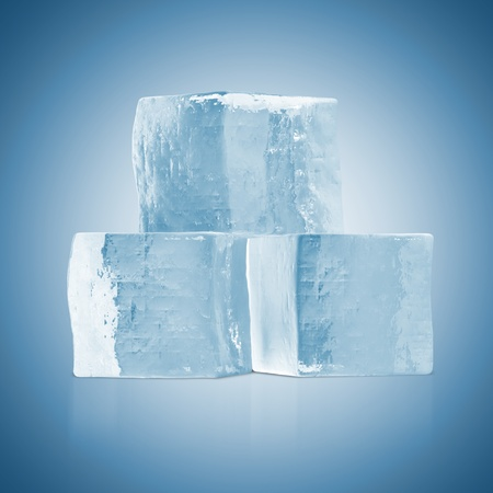 solid food: Ice Cubes on blue background Stock Photo