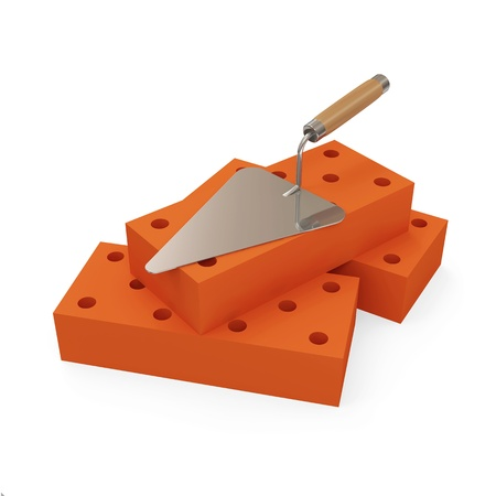 Construction Trowel with Bricks on white background photo