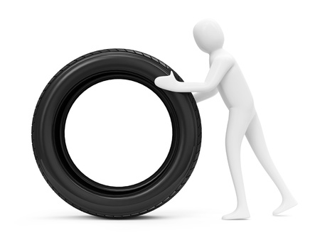3d Man Rolls a Tire Stock Photo - 20141484
