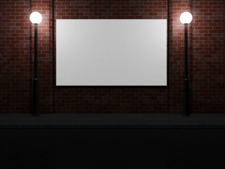 Blank Billboard on a Brick Wall at Night illuminated by Street Lamps photo