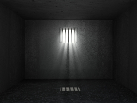 Old Grunge Prison Interior with sun rays breaking through a barred window photo
