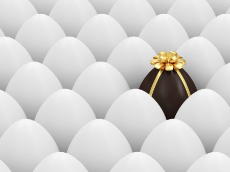 Chocolate Easter Egg standing out from the others  Easter Concept photo