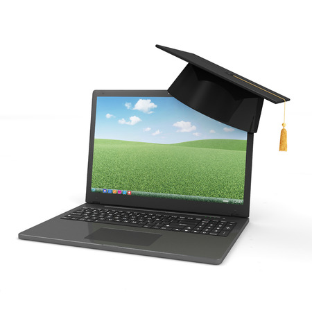 Modern Laptop with Graduation Cap isolated on white background  Education Concept photo