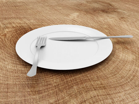 White Plate with Fork and Knife on Wooden Table photo
