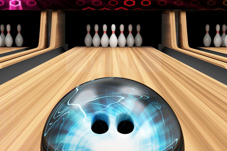 木製の車線にボウリングのボールが転がっています。