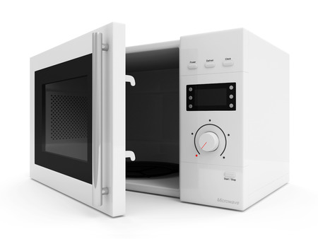 Open microwave oven isolated on white background photo