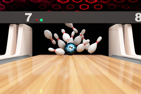 Bowling Strike  Bowling Ball crashing into the Pins on Wooden Lane photo
