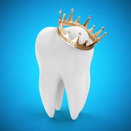 Tooth with Golden Crown on blue gradient background photo