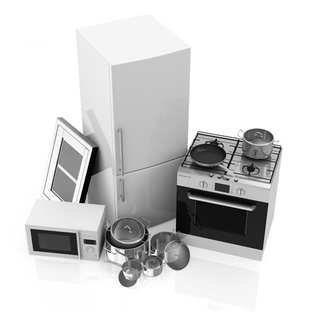 Group of Kitchen Appliances  Refrigerator, Gas cooker, Microwave, Cooker hood and Group of Steel Pans isolated on white background photo