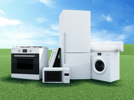 kitchen appliances: Group of home appliances on Beautiful Landscape with Clouds and Sun. Refrigerator, Gas cooker, Microwave, Cooker hood, Air conditioner and Washing machine. Stock Photo