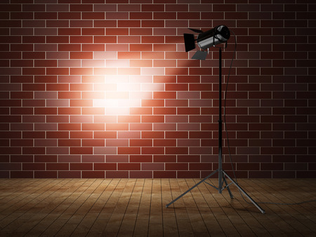 Empty Grunge Photo Studio with Brick Wall and Spotlight photo