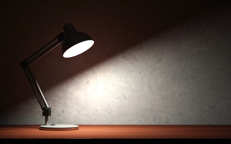 Metal Desk Lamp at Night on the Wooden Table Stock Photo