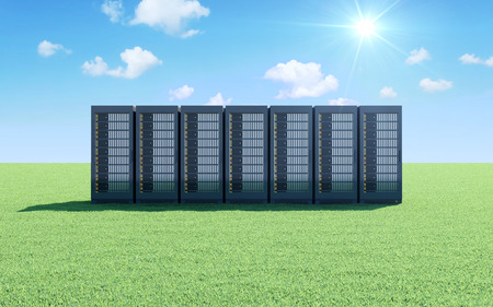 Cloud Computing Storage Information Concept. Modern Servers Rack on a Beautiful Landscape with Green Grass Sunshine and Flowing Clouds over Blue Sky Stock Photo