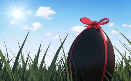 Happy Holiday Easter Concept. Chocolate Easter Egg with Red Ribbon in a Green Grass with Clouds and Sun photo