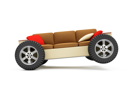 home furniture: Moving to a New Residence or Furniture Transportation Concept. Modern Sofa on Wheels with Pillows isolated on white background Stock Photo