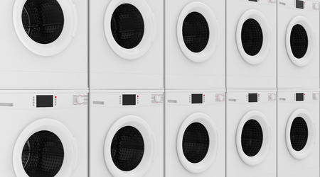 laundry concept: Closeup View at Row of Modern Washing Machines Abstract Background. Laundry Concept Stock Photo