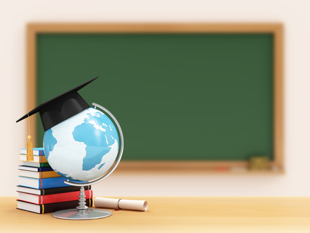 focus on a foreground: Education Concept. Desk Globe with Graduation Cap, Diploma and Books on a School Desk with Green Chalkboard on a Wall behind. Elements of this image furnished by NASA. Focus Foreground.