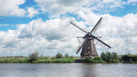 Old Wooden Windmills on Beautiful Landscape near the River