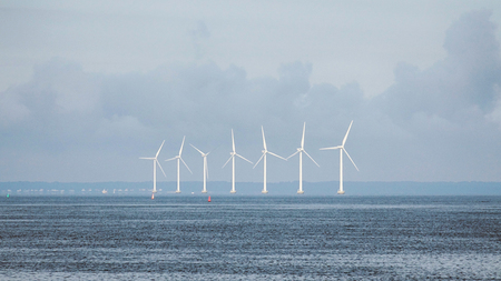 View of the Modern Wind Farm in the middle of the Beautiful Sea Scenery