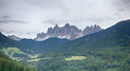 Amazing Italian Alps Dolomites Aerial View with Green Fields and Forest