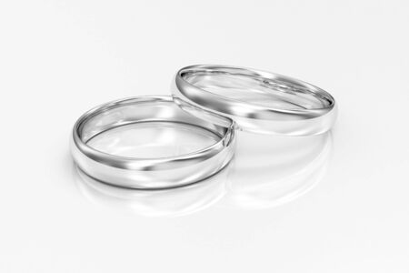 White Gold Wedding Rings on white reflective Stok Fotoğraf