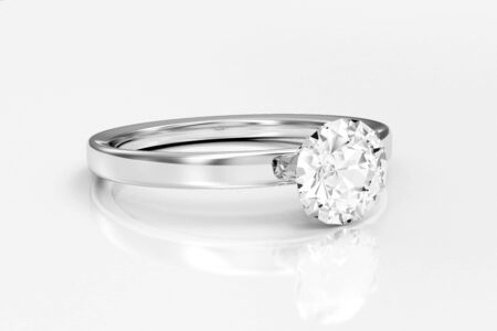 White Gold Ring with Diamond on white reflective Stok Fotoğraf