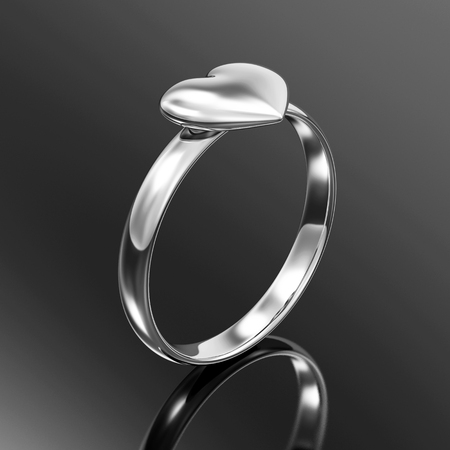 Silver Ring with Heart Shape. Love and Romantic Symbol on black background